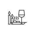 Romantic dinner with candles line icon
