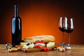 Romantic dinner with cheese and wine still life various gourmet red Royalty Free Stock Photos