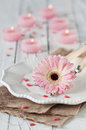 Romantic dinner with gerberas and candles selective focus Stock Image