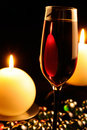 Romantic Dinner - Glass of Red Wine and Candles Stock Photos