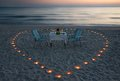 Romantic dinner on the sea beach with candle heart Royalty Free Stock Photo