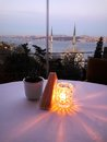 Romantic dinner setting in the restaurant in Istanbul wiht amazing view on the Bosphorus and mosques Royalty Free Stock Photo