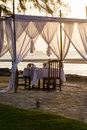 Romantic dinner setup table on the beach Royalty Free Stock Photo
