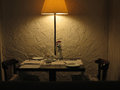 Romantic dinner table for couple served restaurant in with dim lights Stock Images