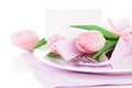 Romantic dinner / table setting with roses tulips and cutlery, Royalty Free Stock Images