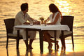 Romantic dinner in the waves Stock Photos