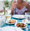 Romantic dinner with white wine in the background a girl is out of focus Stock Photography