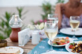 Romantic dinner with white wine in the background a girl is out of focus Stock Image