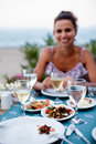 Romantic dinner with white wine in the background a girl is out of focus Royalty Free Stock Photography