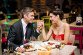 Romantic dinner young happy couple at the restaurant Royalty Free Stock Photos