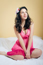 Romantic dreamy lady in pink gown sitting on Royalty Free Stock Photo