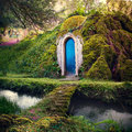 Romantic fairytale home in a magical forest fantasy background d illustration photomanipulation of mossy bridge leading to house Royalty Free Stock Images