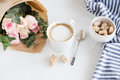Romantic feminine background with coffee and roses Royalty Free Stock Photo