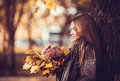 Romantic girl with autumn bouquet in the park Royalty Free Stock Images