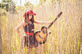 Romantic girl and guitar travelling with her summer hippie style Royalty Free Stock Image