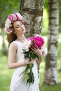 Romantic girl with peony in hands Royalty Free Stock Photo