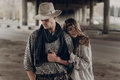 Romantic gypsy woman in stylish boho clothes and white dress hug Royalty Free Stock Photo