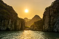 Romantic Halong bay sunset over limestone rocks, Vietnam Royalty Free Stock Photo