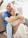 Romantic happy senior man embracing his wife Stock Photos