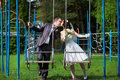 Romantic kiss bride and groom on swing Royalty Free Stock Images