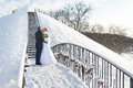 Romantic kiss happy bride and groom on winter day wedding Royalty Free Stock Photography
