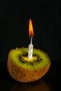 Romantic kiwi -shaped candle Royalty Free Stock Image