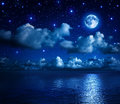 Romantic landscape in the starry night super moon sky with clouds and sea Royalty Free Stock Image