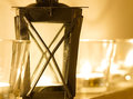 Romantic lantern and candles closeup of old burning in glasses wellness concept Stock Photos