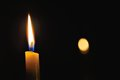 Romantic lighted candle at night Royalty Free Stock Photo