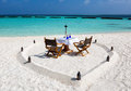 Romantic lunch setup on maldivian beach in front of turquoise waters Royalty Free Stock Photos