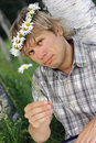 Romantic man giving daisy Royalty Free Stock Images