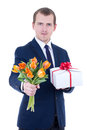 Romantic man giving gift box and flowers isolated on white Royalty Free Stock Photos