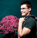 Romantic man holding big bouquet of flowers Stock Photos