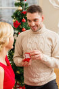 Romantic man proposing to a woman love couple christmas x mas winter relationship and dating concept men women in red dress Stock Photography