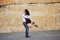 Romantic mature couple having a great time next to the wall of breaks Royalty Free Stock Image