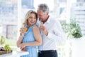 Romantic mature couple holding white wine at restaurant Royalty Free Stock Photo