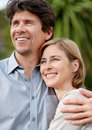 Romantic middle aged couple looking away Stock Image
