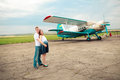 Romantic moments for pregnant couple near plane Royalty Free Stock Photography