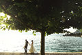 Romantic newlywed couple bride and groom at sunset beach near se Royalty Free Stock Photo