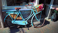 Romantic old bicycle with flowers. Royalty Free Stock Photo
