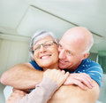 Romantic old man embracing his wife Royalty Free Stock Photography