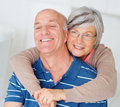 Romantic old woman embracing her happy husband Stock Images