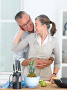 Romantic older couple in Kitchen Stock Photo