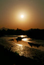 Romantic orange sunset with small curve river Royalty Free Stock Photo