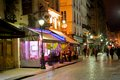 Romantic paris street café at night Stock Images