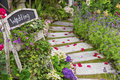 Romantic path to wedding banquet in beautiful green garden Royalty Free Stock Photo