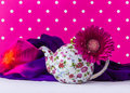 Romantic Pink Still life with Teapot and colorful silk. Royalty Free Stock Photo