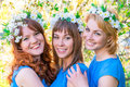 Romantic portrait of three women at the time of flowering cherry Royalty Free Stock Photo