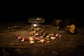 Romantic scene of scattered rosebuds on wood surface Royalty Free Stock Image