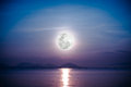 Romantic scenic with full moon on sea to night. Reflection of mo Royalty Free Stock Photo